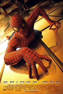 Spider-Man, in his famous suit, crawling over a building, looking towards the viewer, below of him there is New York City and the film's title, credits and release date.