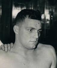 A headshot of Sensanbaugher in a locker room from 1944