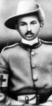 Gandhi in the uniform of a sergeant of the Indian Ambulance Corps. He served during the Boer War (1899).