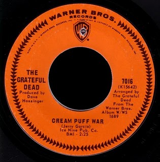 """Cream Puff War"" (1967), the first single by the Grateful Dead. The orange label with chevron border was used on Warner Bros.' American 45s for much of the 1960s. Grateful-Dead WB-7016.jpg"