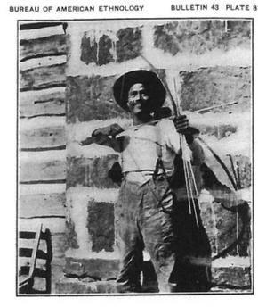 Watt Samm in 1908 holding a bow. From a series of photos taken by John R. Swanton, near Braggs, Oklahoma. Watt Sam 1908.jpg