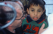 Bob Giuda in Kashmir with Pakistani child orphaned after major earthquake in 2005.