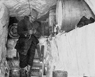 Sverre Hassel in the oil store at Framheim during the winter of 1911 Hassel in the oil-store.jpg