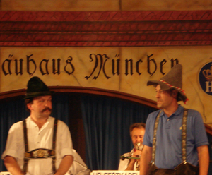 Timothy Rhea - Timothy Rhea (right) participating in a dancing activity at the Hofbräuhaus in Munich, Germany May 2007, featuring traditional German costumes.