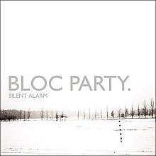 Mostly white album cover with winter image of grey tree line in distance captioned BLOC PARTY and much smaller SILENT ALARM below it