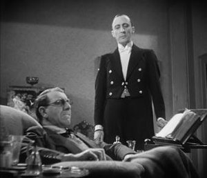 The Impassive Footman - The servant George Curzon towers over his master Allan Jeayes