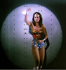 Lynda Carter as Wonder Woman , displaying her ability to deflect