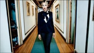 "Haunted (Beyoncé song) - A still from the music video for ""Haunted"" in which Beyonce is seen walking along a corridor in a mansion. The video's set and the singer's style were compared to that of Madonna in her video ""Justify My Love"" (1990)"