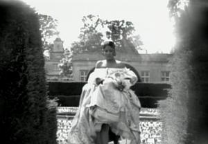 "Breathe Again - Braxton in the video, wearing a ""17th-century"" dress, running through a maze."