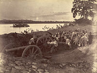 British soldiers dismantling cannons belonging to King Thibaw's forces, Third Anglo-Burmese War, Ava, 27 November 1885. Photographer: Hooper, Willoughby Wallace (1837-1912)