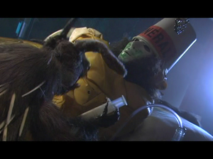 """Enter the Chicken - The """"creature"""" performing taxidermy on Buckethead in the song's promotional video clip."""