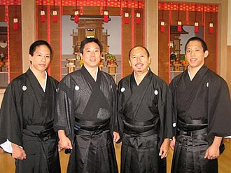 Tenrikyo - Tenrikyo service performers wearing traditional montsuki after a monthly service.