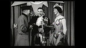 Playing as Sonny MacGregor an impersonator of sorts in the Sonny MacGregor Show in The Naked Truth (1957)