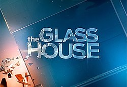 "The title of the series, ""The Glass House"", on a pane of glass."
