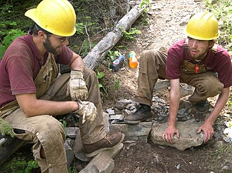Order of the Arrow - Two Arrowmen working on a trail in the Boundary Waters Canoe Area Wilderness.