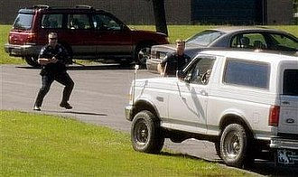 WTLR - Brian Neiman attempts, unsuccessfully, to run over police in the parking lot of WTLR.