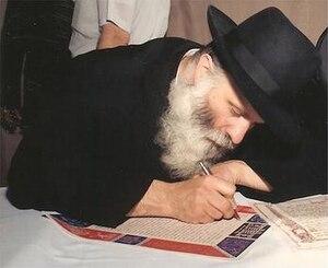 Avrohom Blumenkrantz - Rabbi Blumenkrantz drafting a ketubah at a wedding