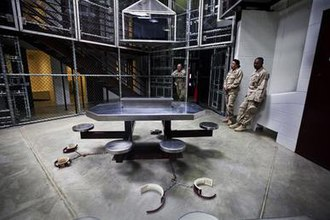 Camp Delta (Guantanamo Bay) - Camp six detainees are shackled to the floor when they watch TV.