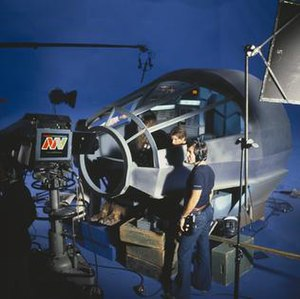 Millennium Falcon - Harrison Ford and Peter Mayhew in the cockpit of the Millennium Falcon during the making of a scene from the Star Wars Holiday Special.