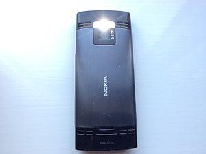 Nokia X2-00 - Back side of Nokia X2-00 with the flashlight turned on
