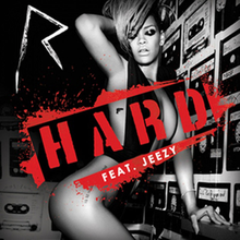 "A woman with short blonde hair wearing only a black top, with the word ""Hard"" imprinted in red across the middle of the artwork."