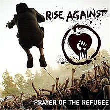 "The back of a man is seen while he is jumping in front of a crowd. To the right of the man, there is a drawing of a fist in front of a heart, with the text ""RISE AGAINST"" above it. In the lower right corner, the text ""PRAYER OF THE REFUGEE"" is displayed."
