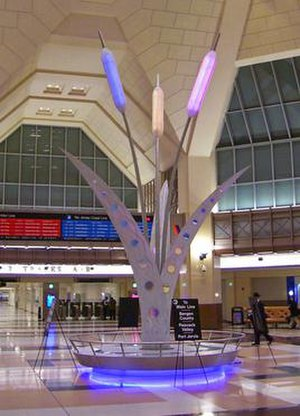 Secaucus Junction - Main concourse, with sculpture symbolizing the Meadowlands and lit in NJ Transit colors