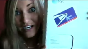 """300-page iPhone bill - A screengrab of blogger iJustine showing her 300-page iPhone bill in a box from a YouTube video titled """"IPHONE BILL"""""""