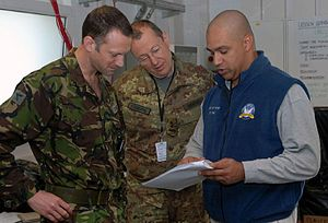 Civilian Response Corps - A member of the Civilian Response Corps trains with military members. Training provides preparedness for civil-military planning services for country engagements and interagency reconstruction and stabilization planning processes.