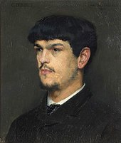 head and shoulder, semi-profile of young man with dark hair, combed forward into a fringe; he has a small beard