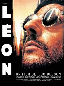 Picture of Jean Reno as Leon. He is bearded and wearing sunglasses looking upwards