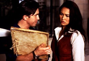 Relic Hunter - Nigel shows an artifact to Sydney.