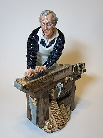 Joiner - The Carpenter, a figurine by Royal Doulton. As a matter of fact the figurine practices joinery, not carpentry.