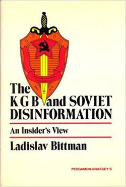 "A soviet shield and sword crest occupies the upper left quadrant of the cover. The title is printed in black at the top of the bottom half with the subtitle ""An Insider's View"" between two thin red lines. The author's name is located under the lower red line, the publisher's name is printed in red in the bottom right corner. The background is a uniform white."