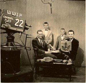 WWLP - A promotional photo of WWLP's Springfield studios in 1960, featuring local businessman Carlton Nash and several dinosaur track specimens found on his property in South Hadley