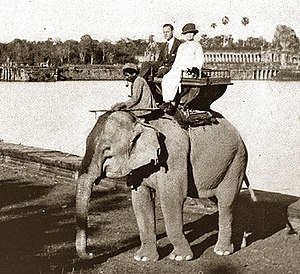 "Helen Churchill Candee - Helen Candee, son Harry, their guide, and ""Effie"" the elephant at Angkor Wat (1922)"