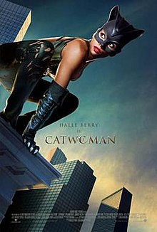 "Movie poster that reads: ""Halle Berry is Catwoman"". In the foreground, Berry wears a leather suit and crouches on the edge of a tall building."