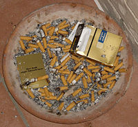 Cigarette butts in ash tray.