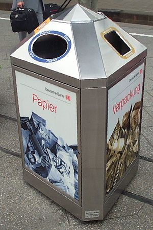 Recycling - A three-sided bin at a railway station in Germany, intended to separate paper (left) and plastic wrappings (right) from other waste (back)