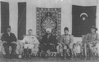 Hindu–German Conspiracy - Mahendra Pratap (centre) at the head of the Mission with the German and Turkish delegates in Kabul, 1915. Seated to his right is Werner Otto von Hentig.