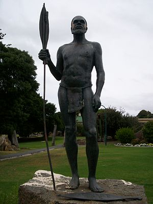 Woomera (spear-thrower) - Mokare with spear and woomera, another woomera lies at his feet.