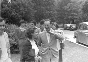 Salvador Luria - Salvador Luria with Esther Lederberg at the 1953 Cold Spring Harbor Symposium. In the background are Aaron Novick, Bruce Stocker, Haig Papazian and Geraldine Lindegren.