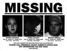 "A black and white missing person poster, with the text ""MISSING"" in upper-case bold typeface, placed atop the images of three young Caucasian individuals. The photo on the left shows a woman in her early 20s; the middle shows a bearded man in his mid-20s, wearing a cap which obscured half of his face from sunlight; and the right shows a man also in his mid-20s, wearing an army hat. Below each of the photos contain their personal information such as age, height, and weight. The bottom of the poster contains a message appealing to contact authorities, followed by an emergency hotline."