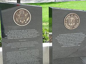 Cerritos Veterans Memorial - Pedestals honoring the Merchant Marines and other groups who contributed to the war efforts. These pedestals are in the vicinity, but not part of the sculpture.