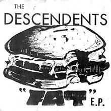 "A white album cover shows a pen-and-ink illustration of a cartoonish cheeseburger with a bite taken out of it. The band's name ""The Descendents"" is printed across the top in large, thin capital typeface. At the bottom is the title ""Fat"" in quotation marks in wide, black, hand-drawn capital letters, followed by ""E.P."" in thin, uneven typeface."