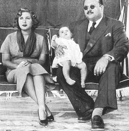 Farouk I with his wife Narriman and their son Fuad II in exile in Capri, Italy (1953) Farouk I, Narriman & Fuad II in Capri.jpg