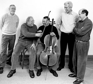 Guarneri Quartet - The Guarneri Quartet in 2001. Retiring cellist David Soyer (seated L) passes the bow to incoming cellist Peter Wiley, as John Dalley, Arnold Steinhardt, and Michael Tree (standing L–R) look on.