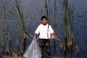 National Cadet Corps (Singapore) - A cadet participating in a community park clean-up project.