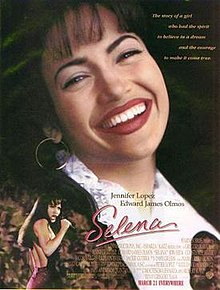 The film poster shows a woman grinning over a live concert. The background is dark with faint faces of those in attendance to the concert, with the names of the two lead actors. The middle has the film's name and tagline, and the bottom contains a list of the director's previous works, as well as the film's credits, rating, and release date.