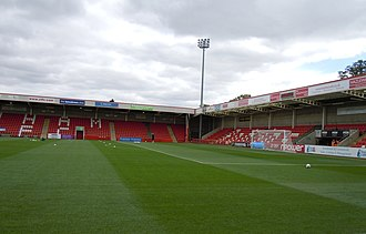 Whaddon Road - Carlsberg Stand and In2Print Stand in 2011